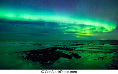 Aurora borealis (northern light) over the sea, Gardur, Iceland
