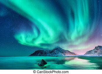 Aurora borealis. Northern lights in Lofoten islands, Norway