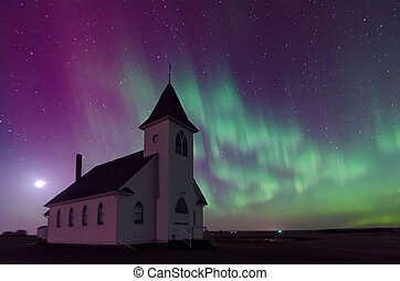 Aurora Borealis over a historic church in Saskatchewan, Canada