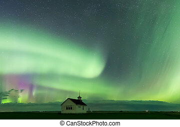 Aurora Borealis over a historical school in Saskatchewan