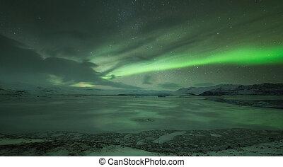 Aurora borealis over Jokulsarlon lagoon in Iceland