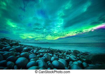 Aurora borealis over ocean. Northern lights