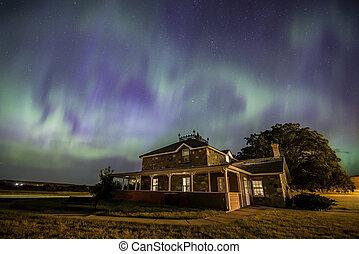 Aurora Borealis over the historic Goodwin House at the Saskatchewan Landing in Saskatchewan, Canada