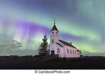 Aurora Borealis over the historic Zion Lutheran Church in Saskatchewan, Canada