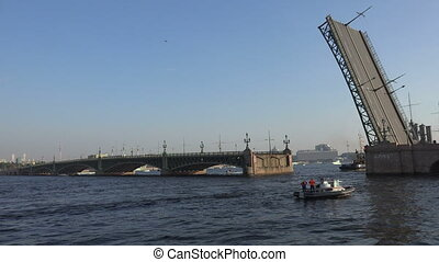 Aurora cruiser passes under bridge span Troitsky drawbridge. Time Lapse. 4K.