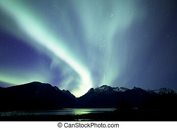 Aurora over Mud Bay - Aurora borealis lights up the sky over...