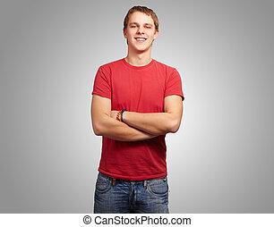 aus, junger, grau, hintergrund, porträt, lächelnden mann