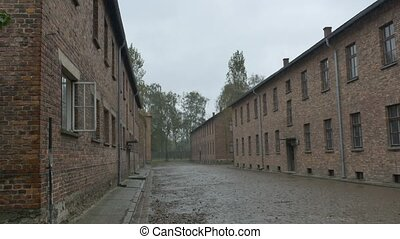 Auschwitz Camp Buildings - Muddy alley beetween buildings in...