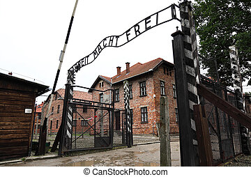 auschwitz entrance gate - famous metal plate of auschwitz...