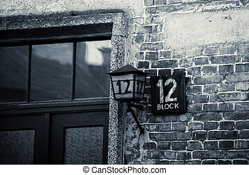 AUSCHWITZ POLAND March 12 2019 Name board and lantern with number 12 at shed block by Concentration Camp.