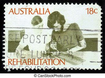 AUSTRALIA - CIRCA 1972: a stamp printed in the Australia shows Amputee Assembling Electrical Circuit, Rehabilitation of the Handicapped, circa 1972
