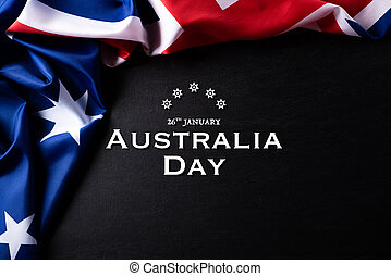 Australia day concept. Australian flag with the text Happy Australia day against a blackboard background. 26 January.