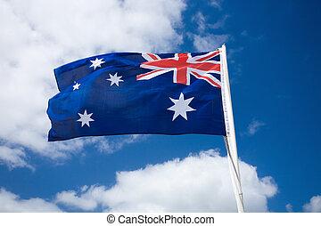 Australia flag against blue sky