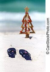 Australia flag thongs on a white sandy beach at Christmas -...