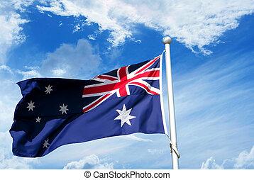 Australia flag waving in blue cloudy sky