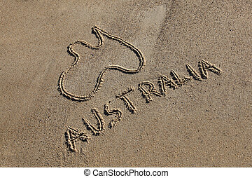 Australia Map and word drawn in the sand at the beach on an ...