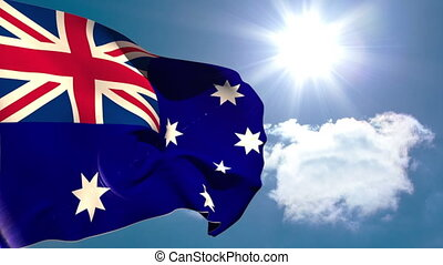 Australia national flag waving on blue sky background with sun and clouds