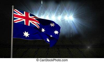 Australia national flag waving on flagpole on black...