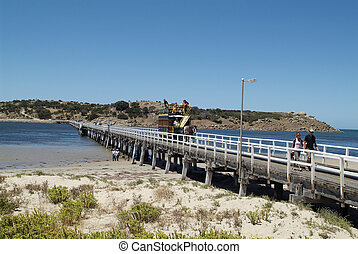 Victor Harbor, Australia - January 30th 2008: Unidentified people on bridge and horse drawn tram, the tram is a nostaglic junction between the village and Granite island