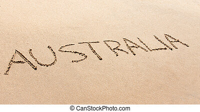 Australia written in the sand on a beach