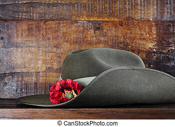 Australian army slouch hat on dark recycled wood with...