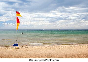 Australian Beach Scene - Lifeguard flags on a stormy...
