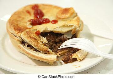 Australian beef pie, broken with meat stuffing