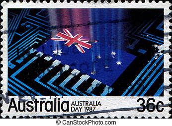Australian flag at the center of computer circuitry -...
