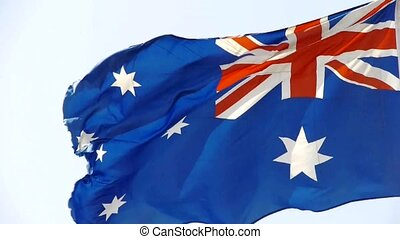 Australian flag flutters in wind.