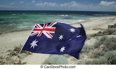Tourism in Australia - Australian flag waving on the...