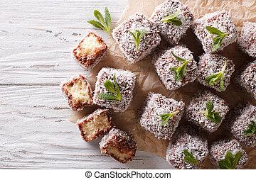 Australian Lamington cake with coconut. Horizontal top view...