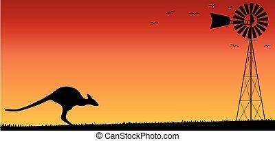 Australian Sunset - A small water pump windmill and a...