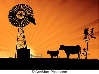 Australian windmill and cows in the outback of Australia