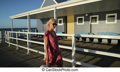 Australian woman traveler - Carefree blonde woman enjoys the...