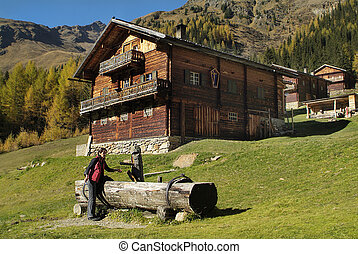 Austria, drinking water well on Staller Alm in East Tyrol
