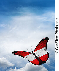 Austria flag butterfly flying on sky background