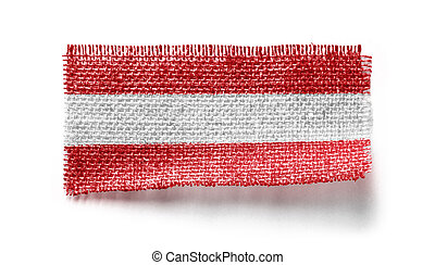 Austria flag on a piece of cloth on a white background