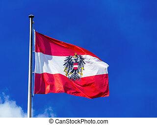 austria flag - the austrian flag waving in the wind against ...