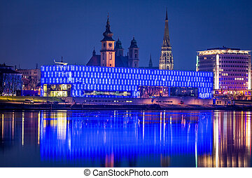 austria, upper austria, linz, lentos. night shot. old and new cathedral