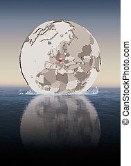 Austria on globe in water