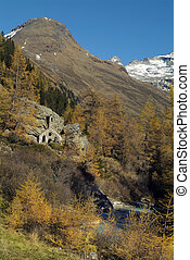 Austria, tchapel named Felsenkapelle aka Rock Chapel built into rock, Gschloesstal Valley in East Tyrol near Matrei village is one of the most beautiful valleys in the Hohe Tauern national park in the Austrian Alps and a popular hiking area