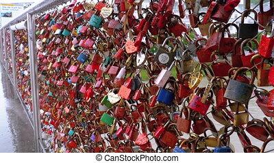 Many Colorful Locks Hanging on Handrails on Love Bridge in Salzburg, Austria