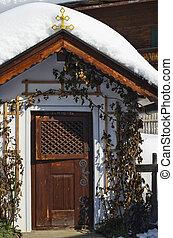 Austria, small chapel with snow cap