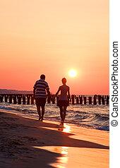 Austria sunset - Austria : a couple on the beach in sunset