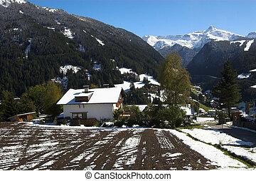 Austrian Alps and house