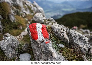 austrian flag as climbing sign in the alps