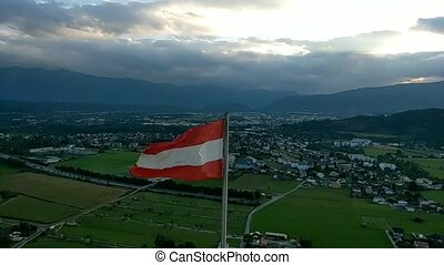 Austrian flag waving at wind with blue sky, loop