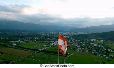 Austrian flag waving at wind with blue sky, loop.