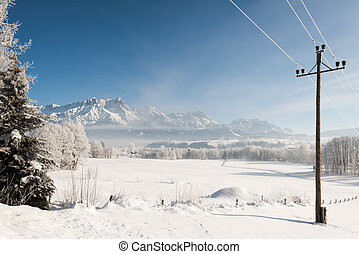 Austrian Winter Wonderland with mountains, a power pole, ...