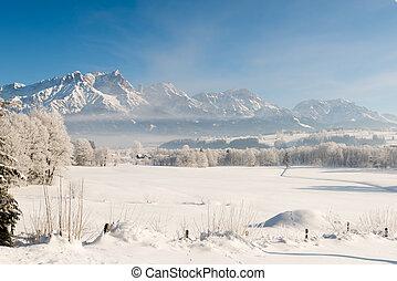 Austrian Winter Wonderland with mountains, fresh snow and haze